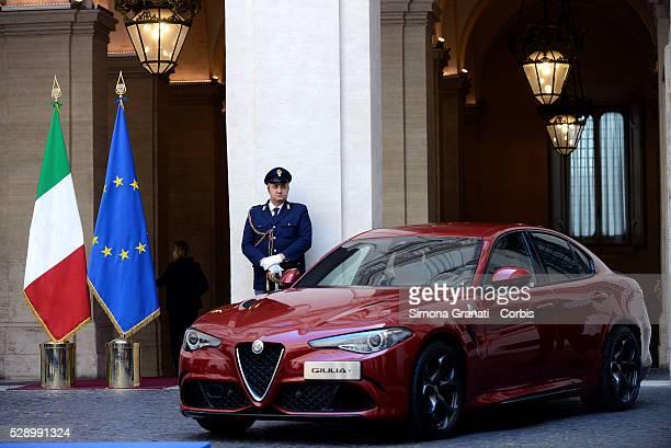 Chairman of Fiat Chrysler Automobiles John Elkann Italian Prime Minister Matteo Renzi and CEO of Fiat Chrysler Automobiles Sergio Marchionne attend...