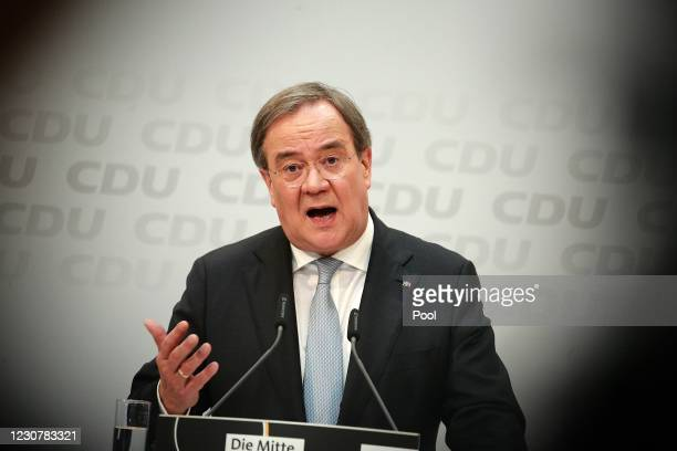 Chairman of Germany's Christian Democratic Union party and Prime Minister of North Rhine-Westphalia Armin Laschet attends a press conference after...