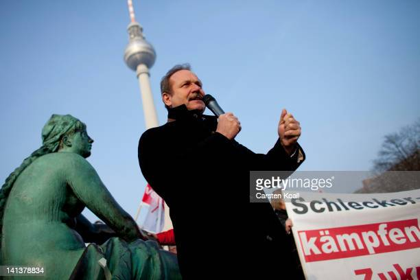 Chairman of Germany's verdi trade union Frank Bsirske speaks to employees of Schlecker drug stores demonstrating against closure later this month on...