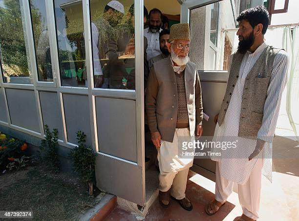 Chairman of hardline faction of Hurriyat Conference Syed Ali Shah Geelani coming out of his house to address a joint press conference on September 9...