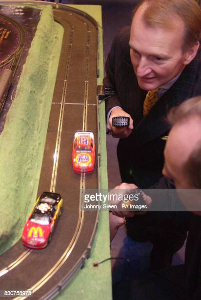 Chairman of Hornby Neil Johnson and his Chief Executive Frank Martin play Scalextric in Hamleys toyshop in London prior to the release of the model...