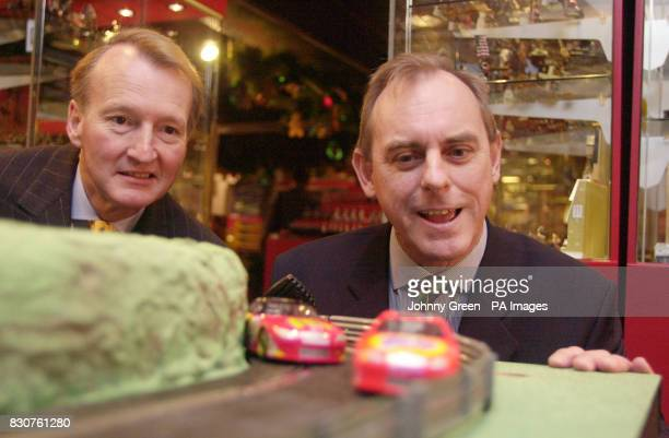Chairman of Hornby Neil Johnson and his Chief Executive Frank Martin play with a Scalextric car set in Hamleys toyshop in London prior to the release...