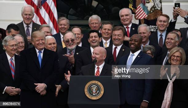 Chairman of House Ways and Means Committee Rep Kevin Brady as President Donald Trump looks on during an event to celebrate Congress passing the Tax...
