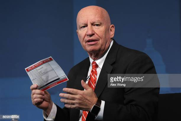 Chairman of House Ways and Means Committee Rep Kevin Brady holds up a postcard size tax form during an event at the Newseum November 3 2017 in...
