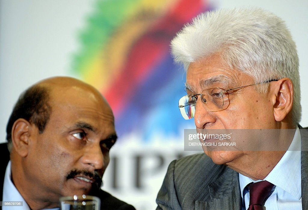 Chairman of Indian software company Wipro, Azim Premji (R) speaks with company Chief Financial Officer (CFO) Suresh Senapati as he announces company financial results at the Wipro campus in Bangalore on April 23, 2010. Wipro announced that fourth-quarter net profit rose more than a fifth as the firm bagged several large deals amid a broad uptick for the sector. Net profit for the three months to March was 12.09 billion Indian Rupees (270 million USD), up 21 percent from 10.01 billion rupees the previous year under international accounting norms. Analysts had forecast a net profit of 12 billion rupees for the Bangalore-based outsourcing firm. AFP PHOTO/Dibyangshu SARKAR