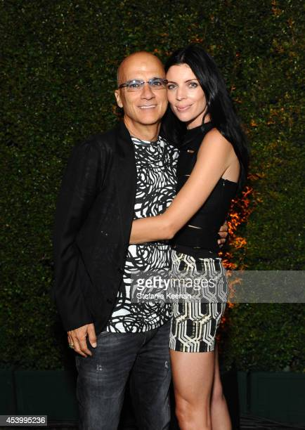 Chairman of Interscope Geffen AM Jimmy Iovine and model and designer Liberty Ross attend GENETIC x Liberty Ross Launch on August 22 2014 in Beverly...
