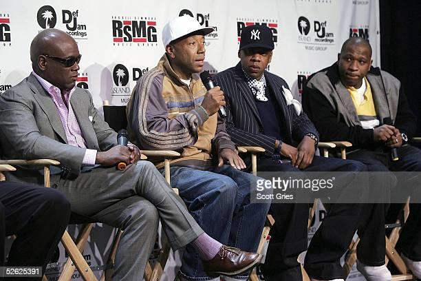 Chairman of Island/Def Jam Antonio LA Reid Russell Simmons Jay Z and President of RSMG Tony Austin talk during a press conference to announce the...