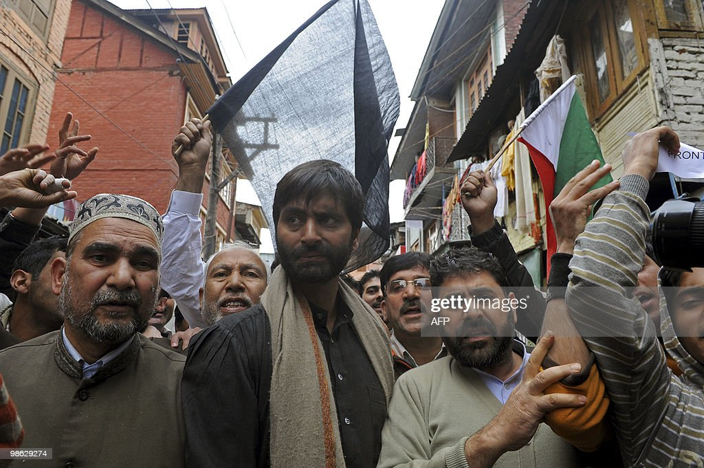 Chairman of Jammu and Kashmir Liberation Front (JKLF) Yasin Malik (C) walks with activists during a protest in Srinagar on April 23, 2010. Police detained activists including Malik during a protest against death sentences handed to three members of a Kashmiri group that bombed a New Delhi market in 1996. Life in Indian Kashmir was crippled by a one-day strike to protest the death sentences. On April 13, one person was killed and 24 hurt during a strike called to protest the initial convictions for the bombing, which left 13 dead and dozens injured in New Delhi's Lajpat Nagar shopping area. Anti-India insurgents have waged a two-decade fight against rule by New Delhi in the Himalayan region that has left more than 47,000 people dead, according to the official count.Seperatists put the toll twice as high. AFP PHOTO/Tauseef MUSTAFA