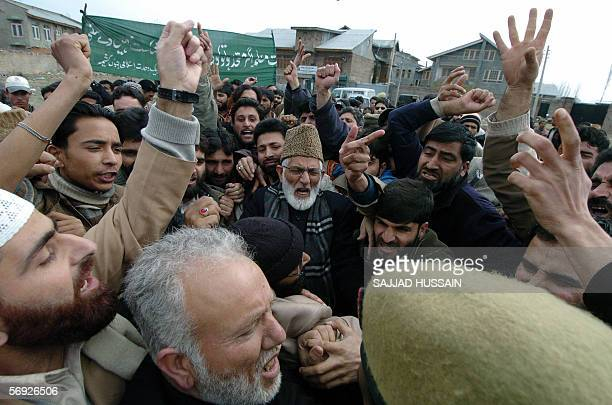 Chairman of Kashmiri All Party Hurriyat Conference Syed Ali Shah Geelani shouts slogans with others as they take part in a demonstration in Srinagar,...