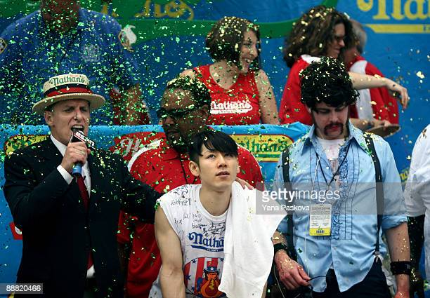 Chairman of Major League Eating George Shea speaks as Takeru Kobayashi of Nagano Japan and Patrick 'deep dish' Bertoletti look on after Joey Chestnut...