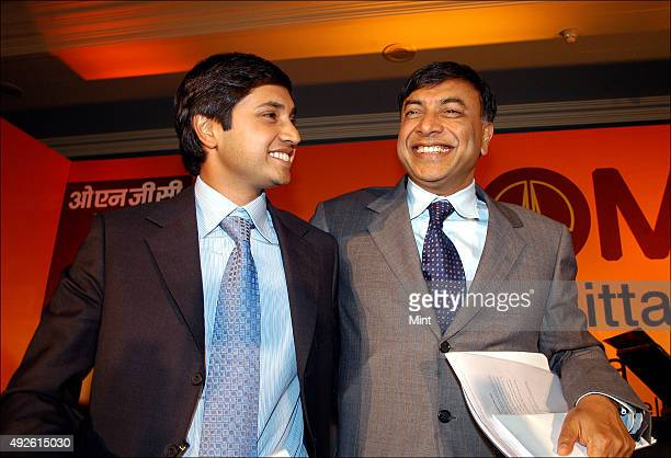 Chairman of Mittal Steel Lakshmi N Mittal with his son Aditya Mittal at a press conference on July 7 2006 in New Delhi India