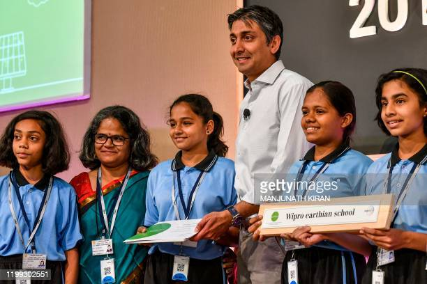 Chairman of multinational corporation Wipro Limited, Rishad Premji poses for photographs with the awardees during the 9th edition of the annual Wipro...
