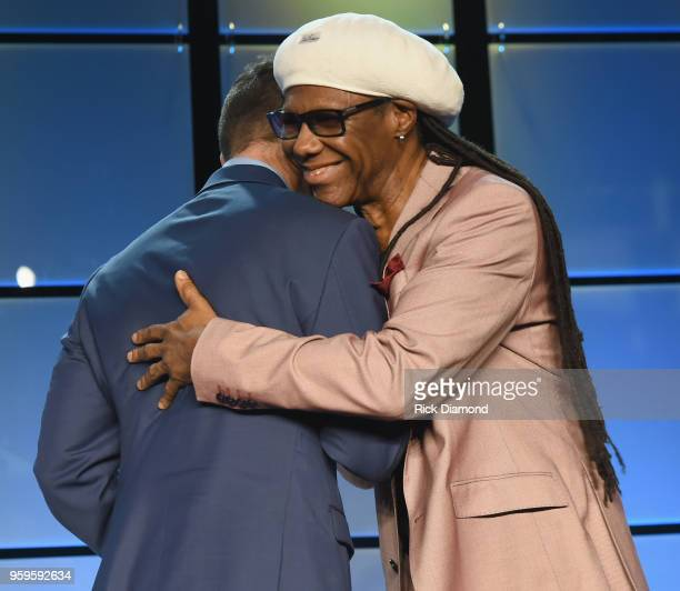 Chairman of Music Biz Fred Beteille presents an award to Nile Rogers onstage during the Music Biz 2018 Awards Luncheon for the Music Business...