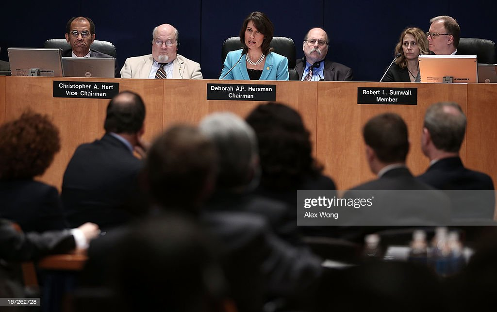 Chairman of National Transportation Safety Board Deborah Hersman (C) speaks as Vice Chairman Christopher Hart (L) and board member Robert Sumwalt (R) listen during an investigative hearing into the Boeing 787 battery fire before the NTSB April 23, 2013 in Washington, DC. The NTSB held a two-day hearing to investigate the design, testing, certification and operation of the lithium-ion battery on the Boeing 787 and the battery fire incident.