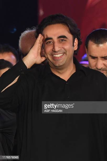 Chairman of opposition party Pakistan People's Party Bilawal Bhutto Zardari gestures to supporters as he arrives on stage during an antigovernment...