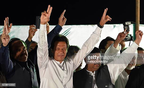 Chairman of opposition party Pakistan Tehreek-e-Insaf Imran Khan waves at supporters during a founding day rally in Islamabad on April 24, 2016. /...