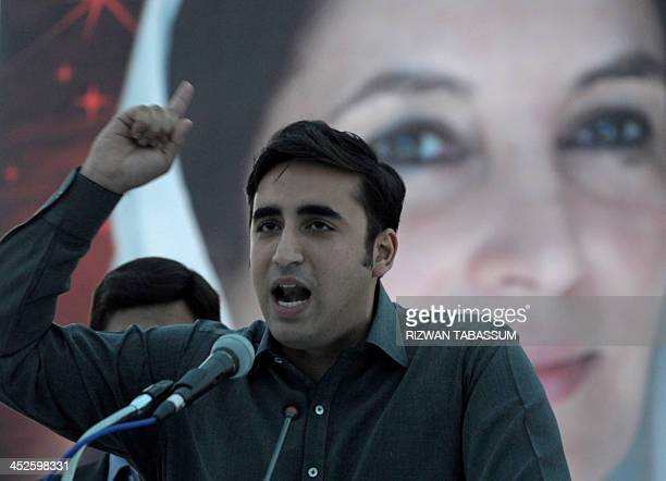 Chairman of Pakistan Peoples Party Bilawal Bhutto Zardari addresses supporters in front of a poster of slain prime minister Benazir Bhutto at a rally...