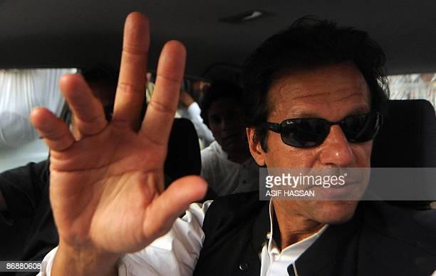 Chairman of Pakistan TehreekiInsaf Imran Khan waves to supporters upon arrival in Karachi on May 10 2009 Khan said that over 15 million Internally...