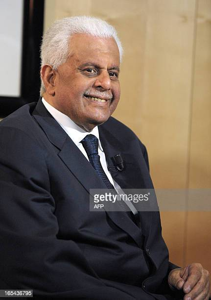Chairman of Qatar's Administrative Control and Transparency Authority Abdullah bin Hamad AlAttiyah smiles prior to start an TV interview during the...