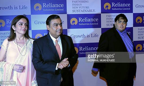 Chairman of Reliance Industries Limited Mukesh Ambani arrives for the company's annual general meeting with his wife Nita and son Anant in Mumbai on...