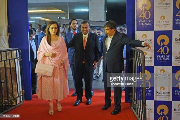 Chairman of RIL Mukesh Ambani with wife Nita Ambani and son Anant Ambani arrives for the 40th AGM of Reliance Industries Limited at Matoshree Hall on...