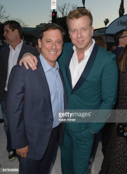 Chairman of STXfilms Adam Fogelson and producer McG attend the premiere of STX Films' 'I Feel Pretty' at Westwood Village Theatre on April 17 2018 in...