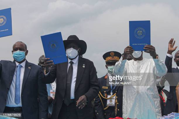 Chairman of Sudan's Sovereign Council Abdel Fattah alBurhan South Sudan's President Salva Kiir and Chadian President Idriss Deby hold a copy of the...