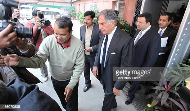 Chairman of Tata Sons Ratan Tata and Cyrus Mistry Deputy Chairman of Tata Sons after a meeting with Commerce and Industry Minister Anand Sharma on...