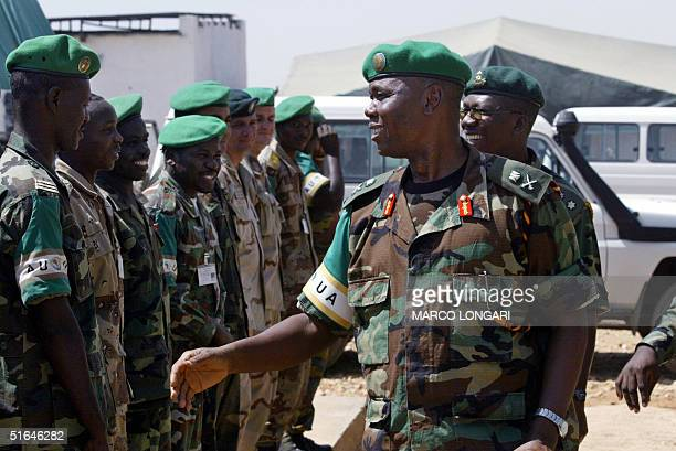 Chairman of the African Union ceasefire commission Major General Festus Okonkwo greets some of his staff inside the AU base in Kab Kabiya north west...