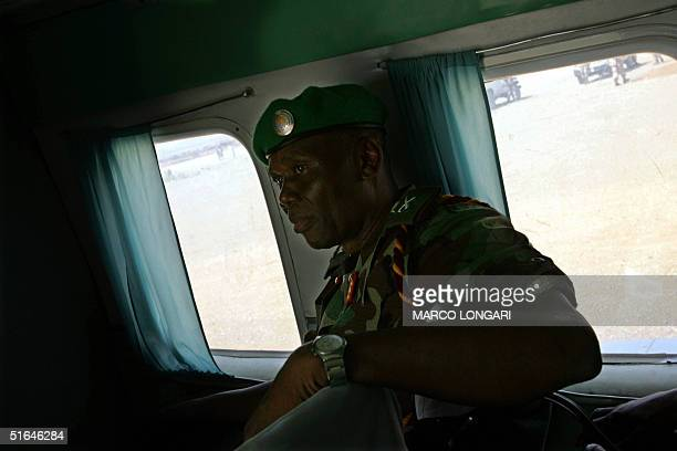 Chairman of the African Union ceasefire commission Major General Festus Okonkwo sits in his helicopter before taking off from the AU base in Kab...