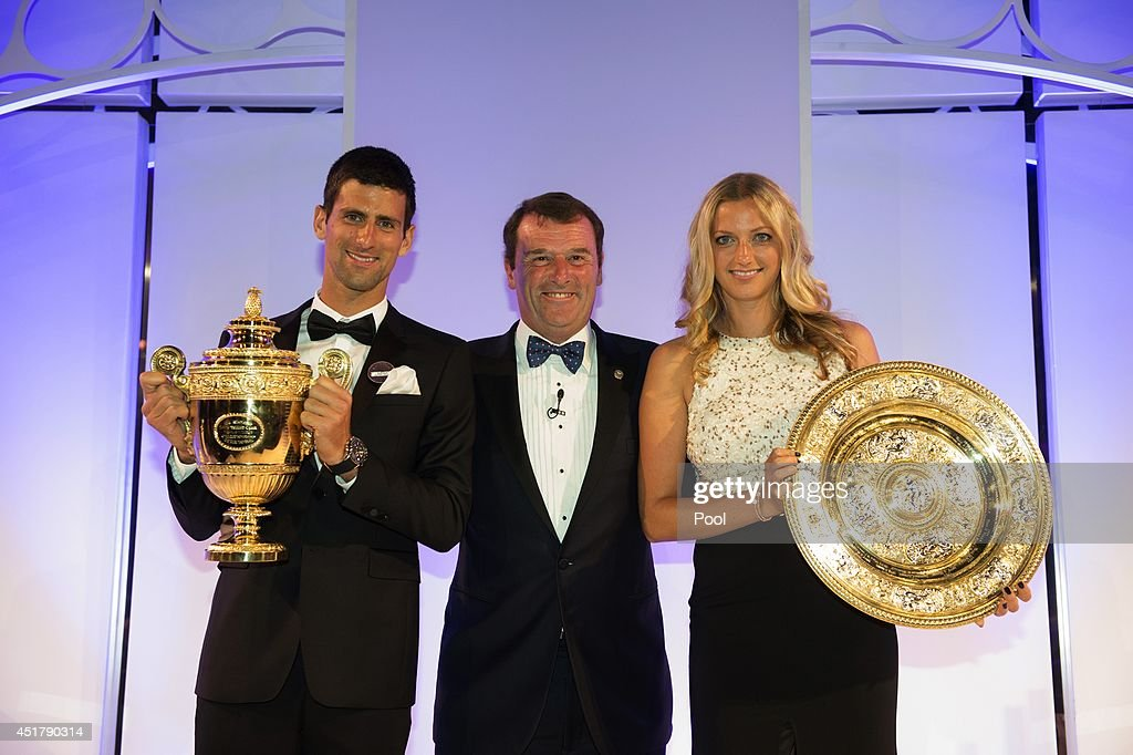 Chairman of the All England Lawn Tennis Club Philip Brook (C) poses with Novak Djokovic of Serbia posing with the Gentlemen's Singles Trophy and Petra Kvitova of the Czech Republic with the Venus Rosewater Dish trophy at the Wimbledon Championships 2014 Winners Ball at The Royal Opera House on July 6, 2014 in London, England.