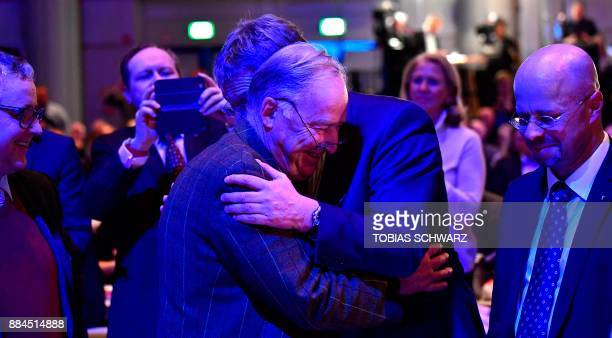 Chairman of the Alternative for Germany farright party Joerg Meuthen congratulates fresh elected CoChairman of the Alternative for Germany Alexander...