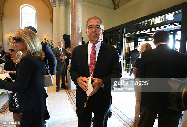 Chairman of the Augusta National Golf Club Billy Payne walks into Saint Vincent Basilica during a Celebration of Arnold Palmer at Saint Vincent...