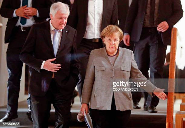 Chairman of the Bavarian Christian Social Union party Horst Seehofer and German Chancellor and leader of the Christian Democratic Union party Angela...