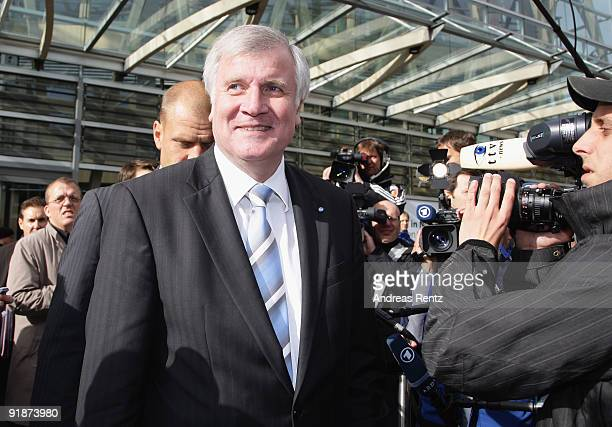 Chairman of the Bavarian sister party to the CDU the CSU Horst Seehofer looks on after the third round of coalition negotiations between the German...