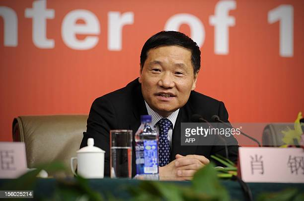 Chairman of the board and secretary of the CPC Party Committee of the Bank of China Xiao Gang attends a press conference during the 18th National...