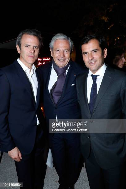 Chairman of the Board of Galeries Lafayette Group Philippe Houze standing between his sons General Director of Galeries Lafayette Nicolas Houze and...