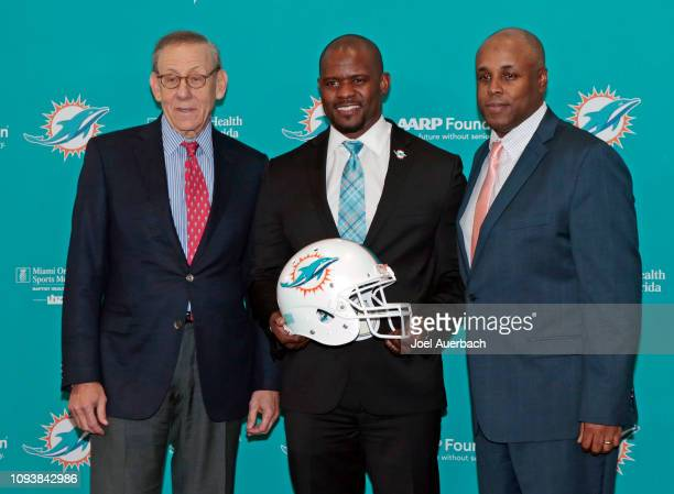 Chairman of the Board/Managing General Partner Stephen M Ross Head coach Brian Flores and General Manager Chris Grier pose for a photograph after...