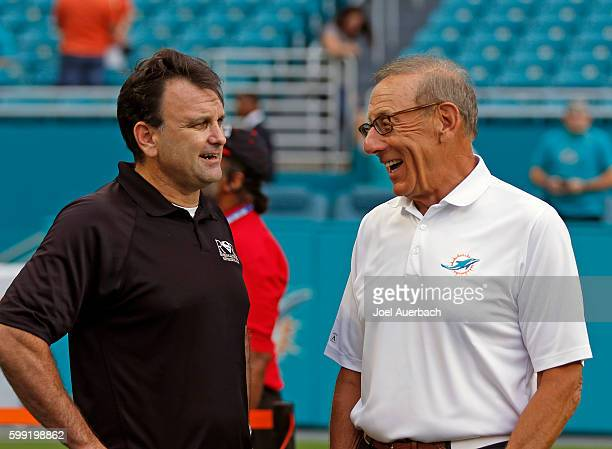 Chairman of the Board/Managing General Partner Stephen M. Ross of the Miami Dolphins talks to sports agent Drew Rosenhaus prior to the preseason game...