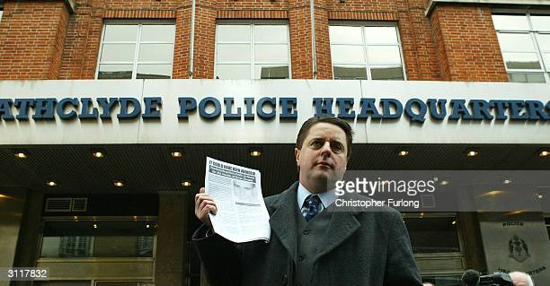 Chairman of The British National Party, Nick Griffin holds a press conference outside Strathclyde Police Headquarters, March 21, 2004 in Glasgow. The...