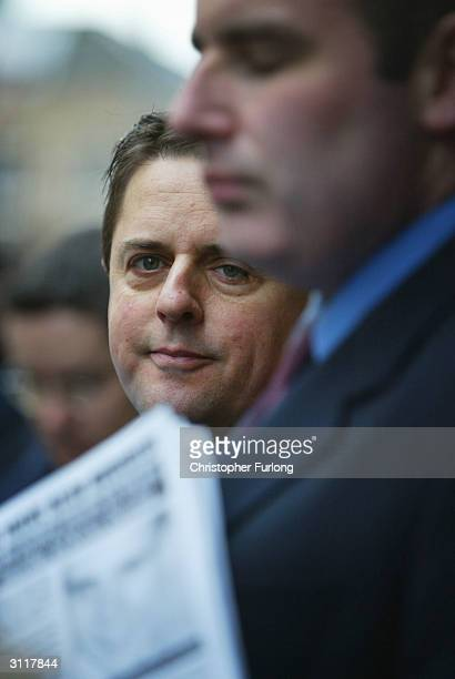 Chairman of The British National Party Nick Griffin, protected by his security team holds a press conference outside Strathclyde Police Headquarters,...