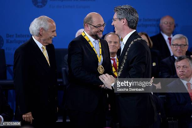 Chairman of the Charlemagne Prize Board Dr Juergen Linden and Major of Aachen Marcel Philipp award European Parliament President Martin Schulz during...