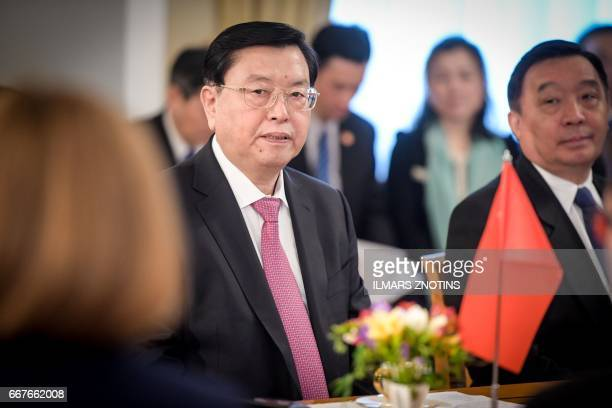 Chairman of the Chinese People's Congress Committee Zhang Dejiang meets with Latvia's President in Riga on April 12 2017 Zhang Dejiang is on an...