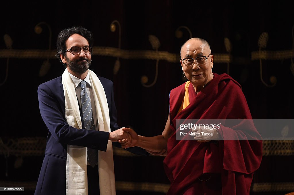 Chairman of the council of Milan Lamberto Bertole shakes hands with the Dalai Lama at the ceremony for honorary citizenship, during the meeting organized by the University Bicocca to the Arcimboldi theater on October 20, 2016 in Milan, Italy. The Dalai Lama spiritual leader of Tibetan Buddhism, starts today the first of a three-day visit and spiritual meetings in Milan.