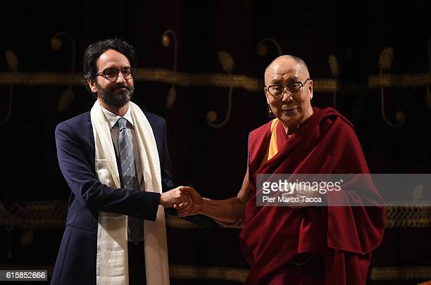 Chairman of the council of Milan Lamberto Bertole shakes hands with the Dalai Lama at the ceremony for honorary citizenship during the meeting...