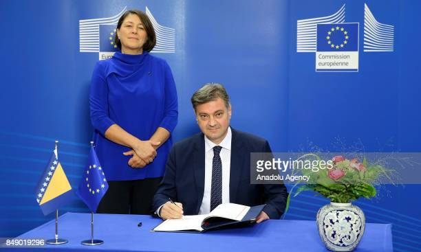 Chairman of the Council of Ministers of Bosnia and Herzegovina Denis Zvizdic signs the Transport Community Agreement as European Commissioner for...