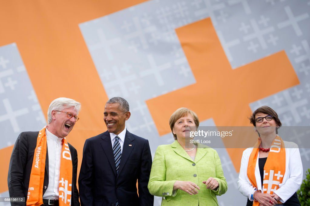Chairman of the Council of the EKD and Bavarian regional Bishop Heinrich Bedford-Strohm, former President of the United States of America Barack Obama, German Chancellor Angela Merkel and president of Church Congress Christina Aus der Au arrive for a discussion on democracy at Church Congress on May 25, 2017 in Berlin, Germany. Up to 200,000 faithful are expected to attend the five-day congress in Berlin and Wittenberg which is celebrating the 500th anniversary of the Reformation.