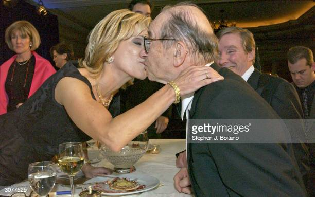 Chairman of the Federal Reserve Alan Greenspan congratulates his wife Andrea Mitchell after receiving the Leonard Zeidenberg First Amendment Award at...