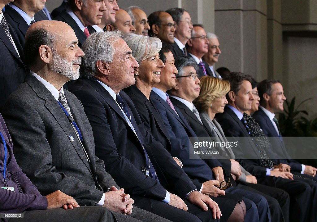 US Chairman of the Federal Reserve Ben Bernanke (L), International Monetary Fund Managing Director Dominique Strauss-Kahn (2nd-L), France finance minister Christine Lagarde (3rd L), South Korean Finance Minister, Yoon Jeung-hyun (4th L) South Korean Central Bank Governor, Jung Su Kim (5th-L), Spain's Minister of Finance, Elena Salgado (4th R), US Treasury Secretary Timothy Geithner (3rd-R), Indonesian Finance Minister Mulyani Indrawati (2nd-R) and Mark Carney, governor of the Bank of Canada (R) participate in a group photo op at the International Monetary Fund on April 23, 2010 in Washington, DC. Finance Ministers and Central Bank Governors are attending spring meetings at the IMF and World Bank Headquarters.