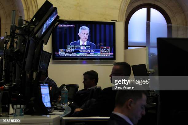 Chairman of the Federal Reserve Jerome Powell is displayed on a television as traders and financial professionals work ahead of the closing bell on...
